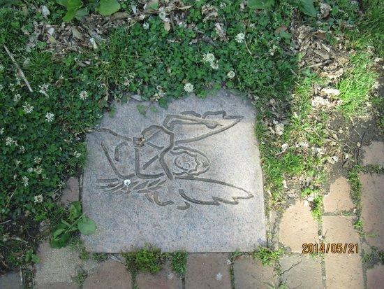 """Thomas Wolfe Memorial: sidewalk tile of the angel of """"Look Homeward Angel"""""""