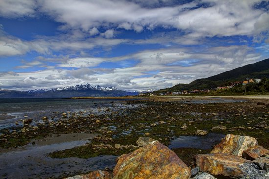 Los Cauquenes Resort & Spa: View from the beach of the Beagle Channel, the hotel / spa is a  bit in the distance from this p