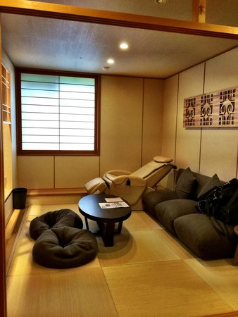 Beautiful living room with a massage chair - Picture of Niseko Konbu ...