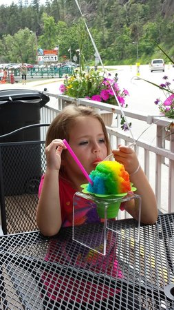Island Oasis Hawaiian Shave Ice : Enjoying the ice and watching the cowboys in the street.
