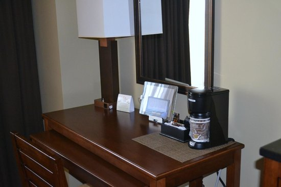 Grand Casino Hotel: Ipad and coffe maker on desk.