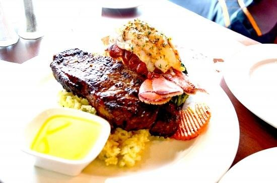 Sandstone Grillhouse: well-done New York steak with lobster tail