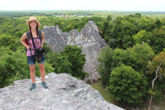 Explorean Kohunlich : Nellie atop a pyramid at some of the Mayan ruins.