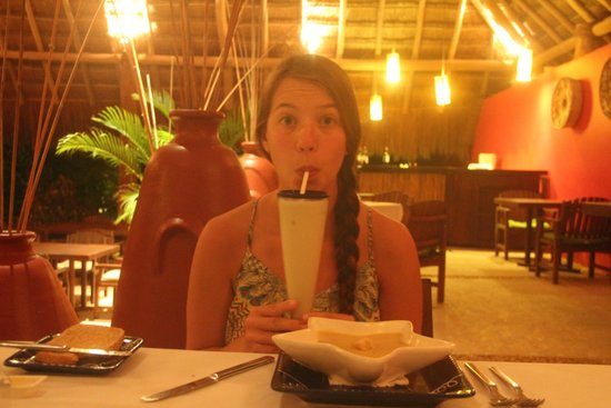Explorean Kohunlich : Nellie enjoying her pina colada at dinner.