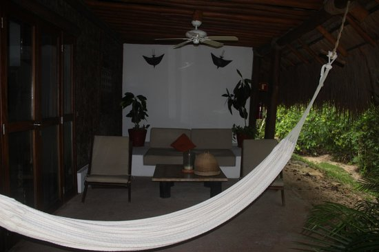 Explorean Kohunlich : Our patio, with chairs, hammock and candles.