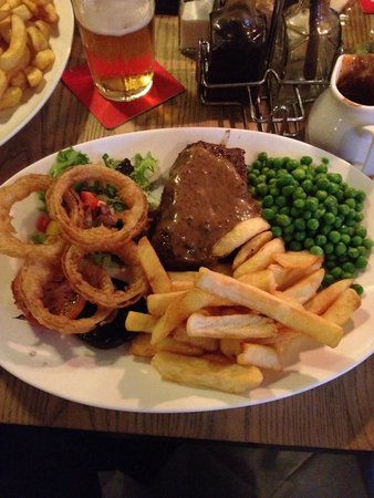Withy Arms : Great rump steak, cooked to perfection. Onion rings were amazing but the peppercorn sauce was st