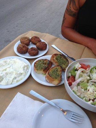Maro's Taverna: tzatiki dip , cheese zucini balls, garlic toast and a greek salad