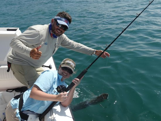 Pepe's Charters : Capt Pepe and Wife with Tarpon