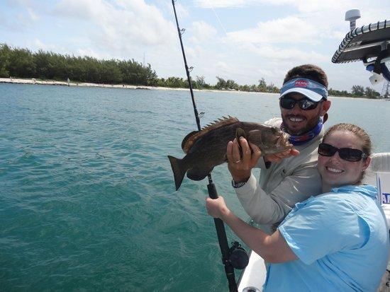 Pepe's Charters : Capt Pepe and Tamara with Grouper