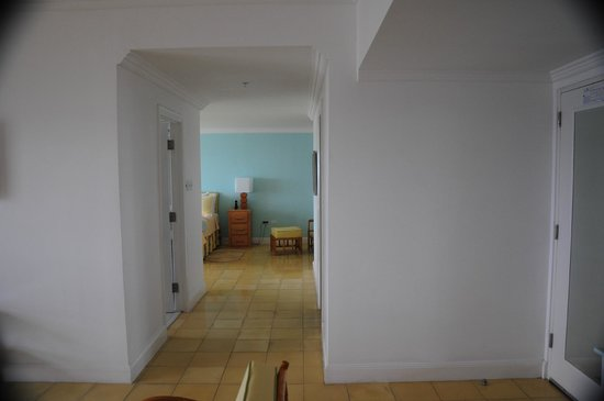 Couples Tower Isle: Looking from the sitting area to the bedroom in a one bedroom suite .