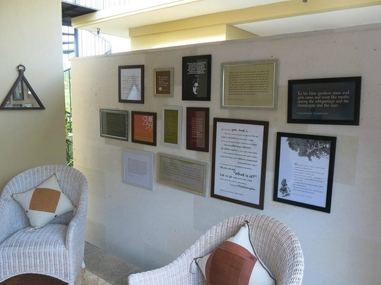 Villa Nirvana Bali: The wall of the dining area of the Writer's Suite is decorated with examples of beautiful writin