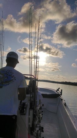 Reel Action Fishing Charters: Captain Johnny and morning sun