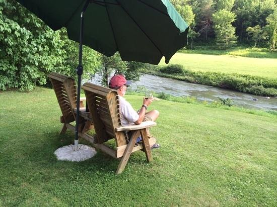 The Woodbridge Inn: ... late afternoon drink by the Ottauqueechee River.