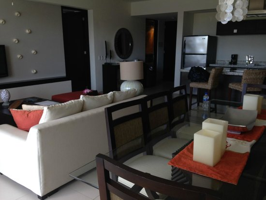 Marival Residences Luxury Resort : living room area with pull out couch
