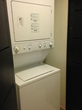 Marival Residences Luxury Resort : washer/dryer combo in room 212