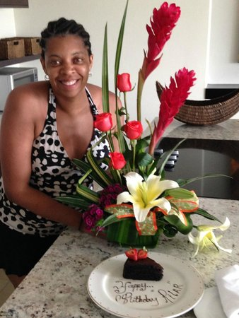 Marival Residences Luxury Resort : birthday flowers and cake…..planned by my husband and the concierge