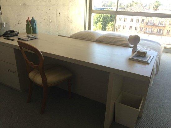 The Line La Desk Behind Bed Headboard With Safe On Bottom Left Side