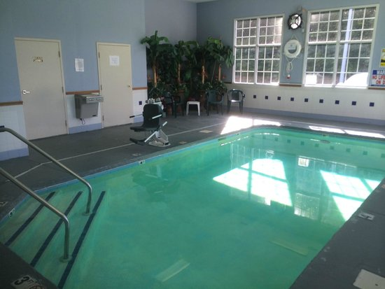 Super 8 Fayetteville: Pool facing back. Bathroom and Laundry room doors behind pool