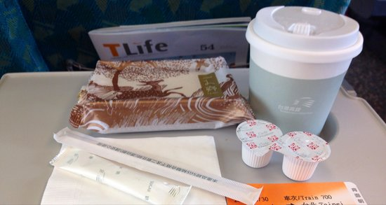 Taiwan High Speed Rail Taichung Station : Snacks are sold on board HSR. Coffee & cake for NT$60 only.