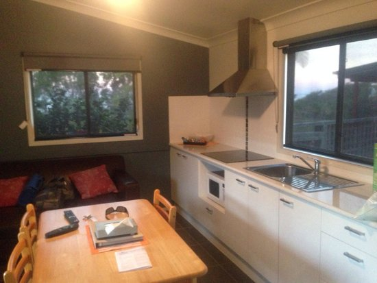 North Coast Holiday Parks Nambucca Headland: Cabin 1 kitchen and family room.