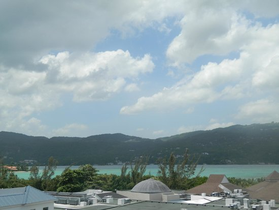 Secrets Wild Orchid Montego Bay: mountains of Jamaica from hotel breezeway to room