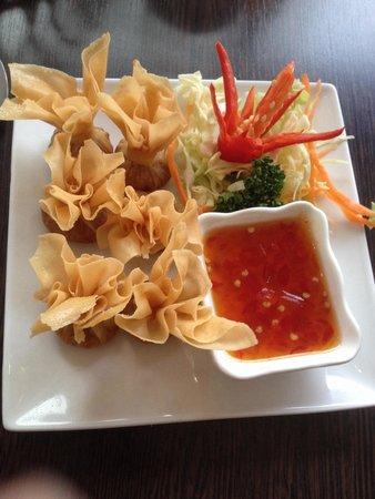 Sukawatee: Golden bags - minced pork and prawn parcels with sweet chilli sauce.