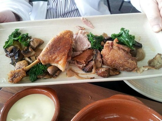 Ole Fuego: Confit of Duck with Sauteed wild mushrooms