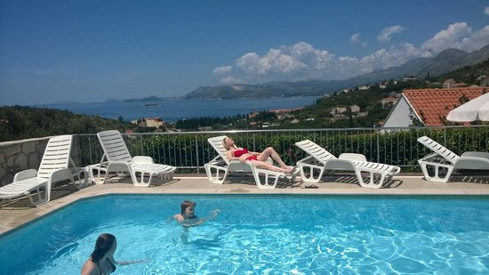 Apartments Zvrko: A day by the pool