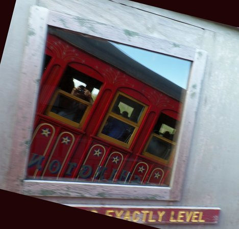The Mount Washington Cog Railway: Shows the angle.  Shot is train reflected in building.  Level at bottom is true.