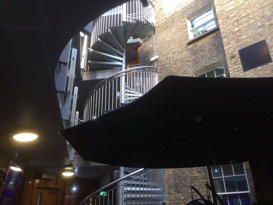 The Z Hotel Soho: Courtyard Area with spiral staircase to upper floors where the hotel rooms are (there is a lift