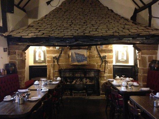 The Tudor House: Restaurant fireplace