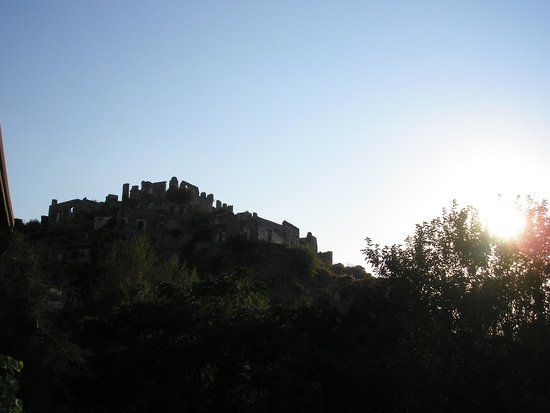 Kaya Levissi Garden: View from outside as sun goes down