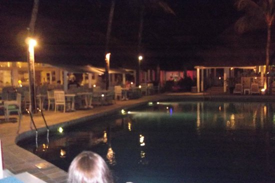 Merville Beach Hotel: pool area by night