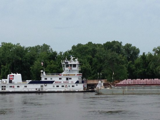 Riverboat Twilight: A picturesque little tug near Guttenberg.