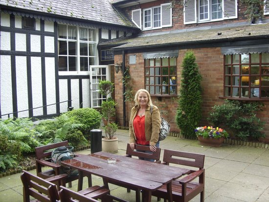 The Lymm Hotel: On terrace at the back entrace of the hotel