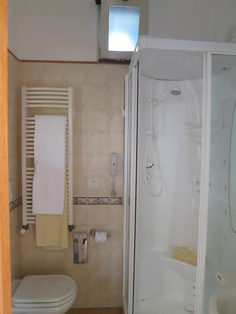 "Hotel Villa Schuler: Bathroom's warming towel ""ladder"" (note color-coded gold, white towels) (room #16)"
