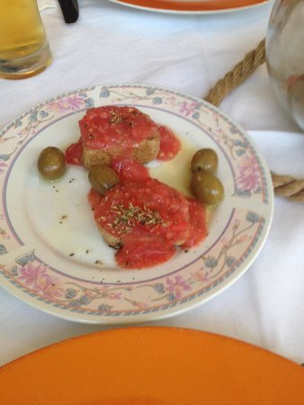 Le Gourmet : Courtesy of the chef. Bread with tomatoes and olives.