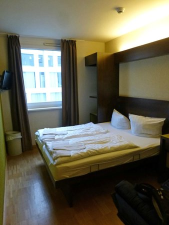 "MEININGER Hotel Berlin Hauptbahnhof: Two bed room, cannot separate beds, ""closet"" shelves next to window"