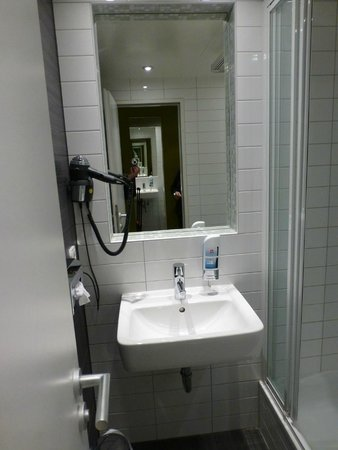 MEININGER Hotel Berlin Hauptbahnhof: sink and wall mounted hairdryer