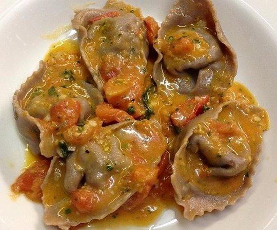 IL VICOLETTO: Chestnut cappellacci with wild boar in tomato sauce