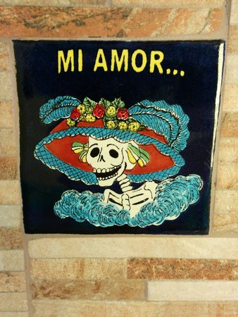 La Hacienda: One of the calavera-like tiles that are throughout or the hallway.