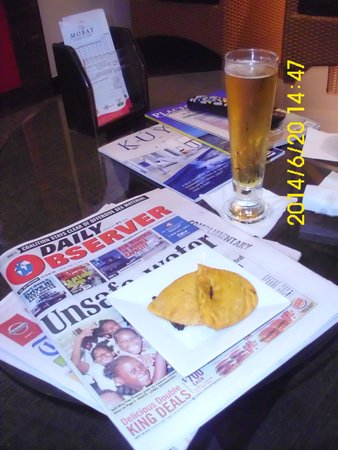 Club Mobay Departure Lounge: TV time, something to read and a Talll Glass of Red Stripe