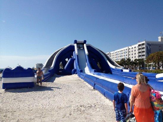 TradeWinds Island Grand Resort : beach inflatable water slide