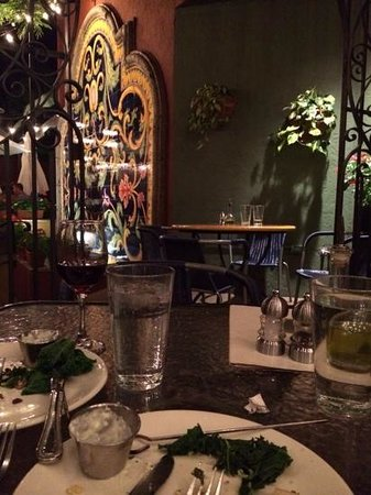 The Mediterranean Restaurant: patio with fountain wall