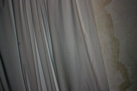Hacienda La Cienega: filthy curtain on skylight leaking and full of bugs!