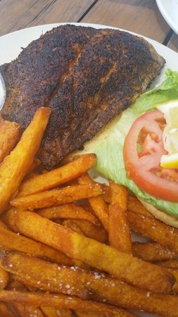 Boatyard Waterfront Bar and Grill: Blackened grouper sandwich and sweet potato fries