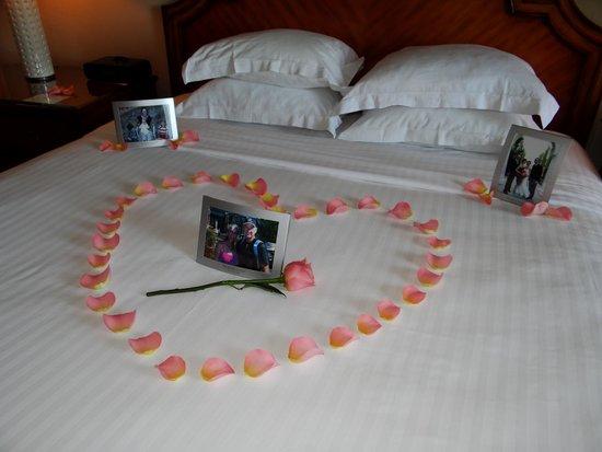 The Ritz-Carlton, Half Moon Bay: rose petals & family photos on bed