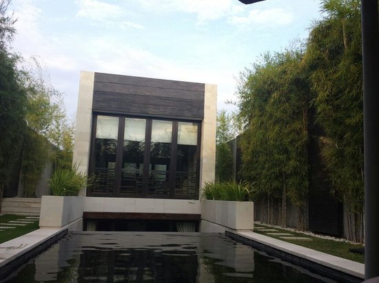 eqUILIBRIA SEMINYAK : View of Signature Villa from pool lounge chairs