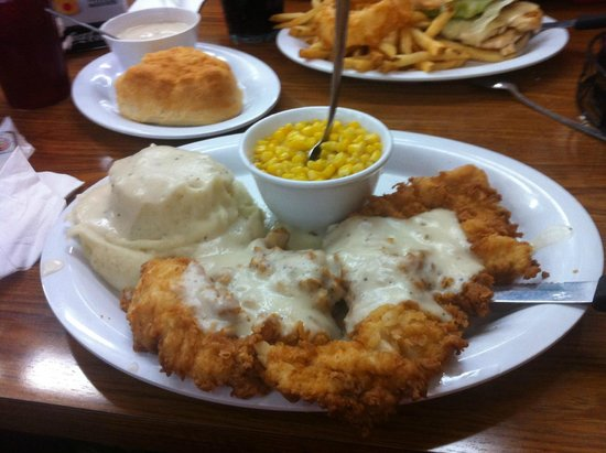 Kelley's Country Cookin': Chicken Fried Chicken with mashed potatoes & corn -cream gravy