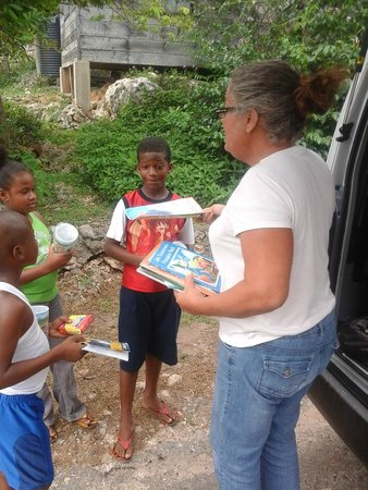 Turner Taxis and Tours Jamaica: Our client stop and give away books to the kids